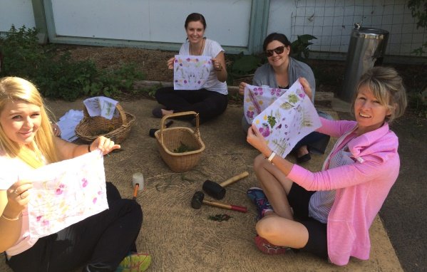 Leaf rubbings are proudly displayed by participants at the fresh